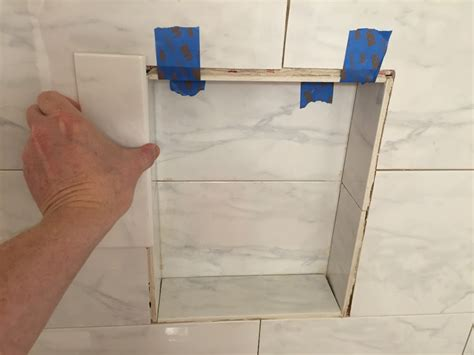 Can i glue a decorative tile to the existing tile for a shower niche home improvement stack