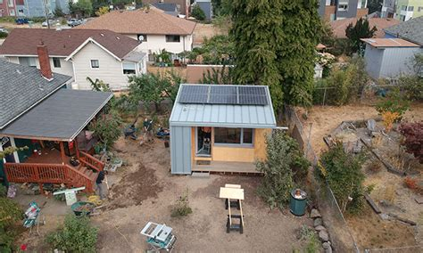 new tiny house neighborhood will allow homeless to rent to own would you put a tiny house for a homeless person in your