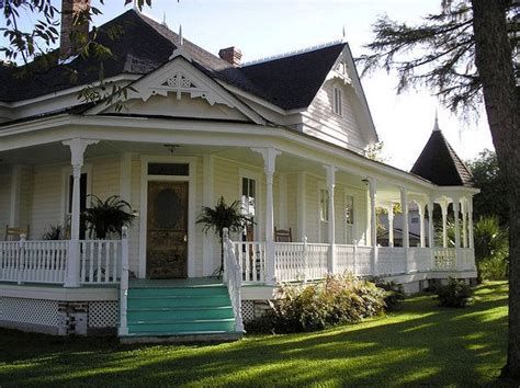 what a beautiful old country home awesome wrap around porch and i love the teal steps