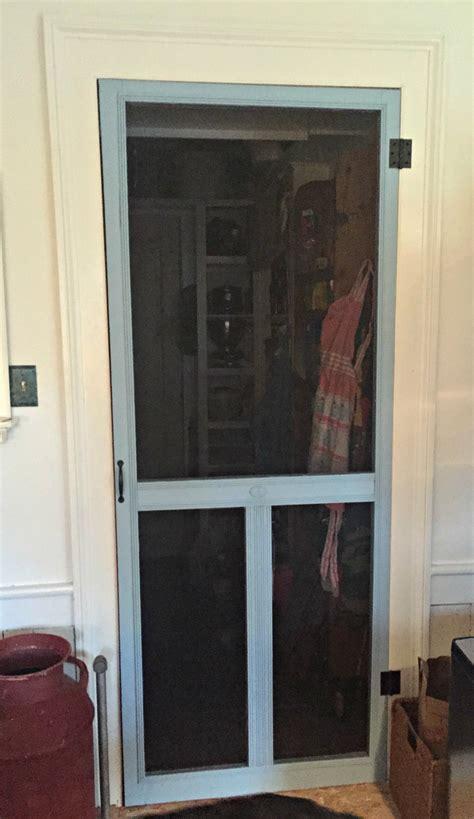 inside screen door porch to pantry screen door holds court inside