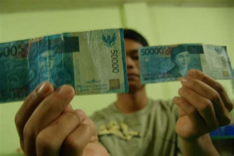 Ciri Ciri Jw Asli Dan Palsu perbedaan dan ciri ciri uang asli dan palsu uang indonesia