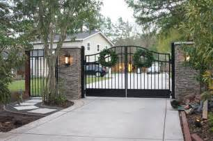 Gate with stacked stone pillars contemporary exterior san