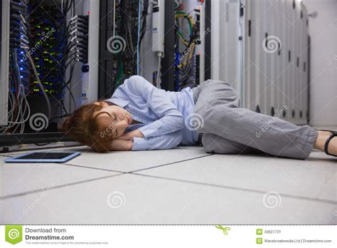 Sleep Floor by Exhausted Technician Sleeping On The Floor Stock Photo
