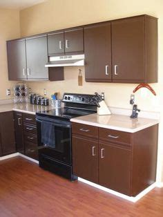 can you re laminate kitchen cabinets how to refinish quot garage style quot kitchen cabinets maybe