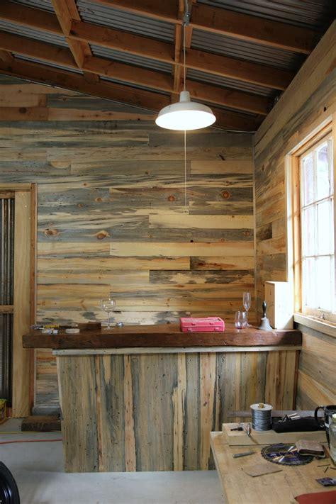 reclaimed wood planks for walls diy pipe shelf reclaimed wood plank walls