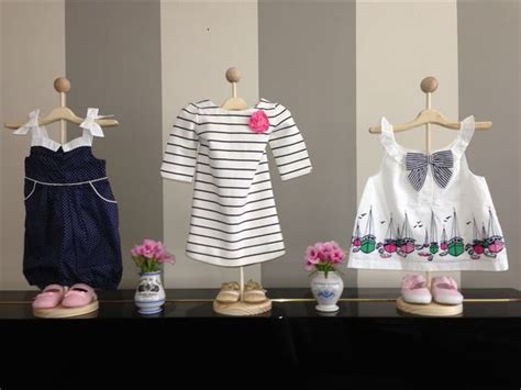 Baby Shower Boutique by Use Stands To Display Baby Clothes For Decorations