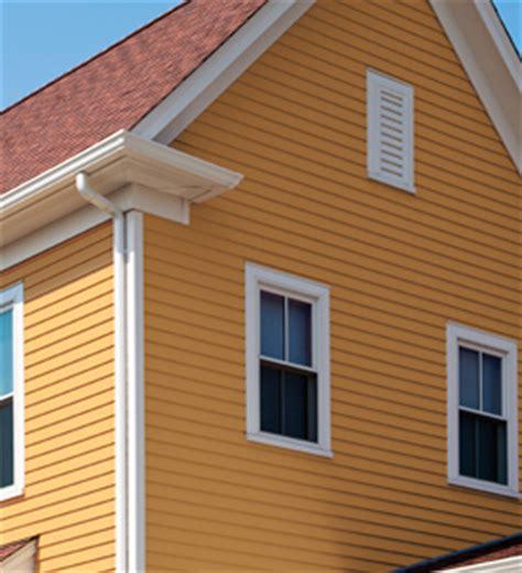yellow siding house contact us apex siding system