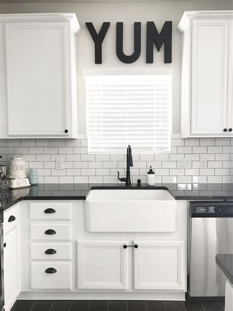 white kitchen cabinets with black hardware black white and teal kitchen farmhouse sink source