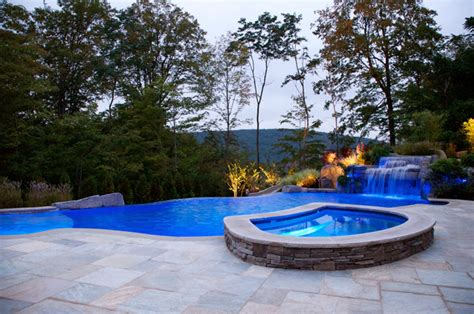 backyard infinity swimming pool waterfall design bergen
