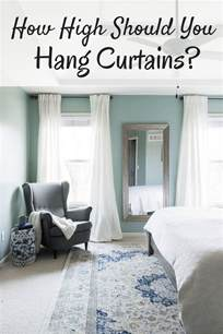how high should you hang pictures how high to hang curtains happymeetshome