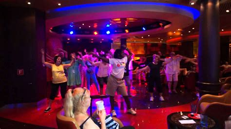 who is black girl dancing on cruise ship commercial 70 s dance class at boleros oasis of the seas cruise ship