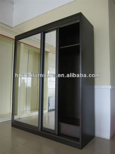 Laminate Wardrobe Door Designs by Walnut Color Laminate Wardrobe Designs Home Wardrobe View