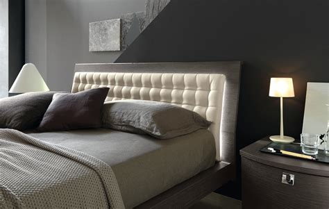 backlit headboard bright masculine bedding in bedroom contemporary with led