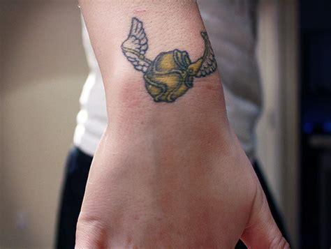 upper wrist tattoos cool harry potter wings symbol on wrist