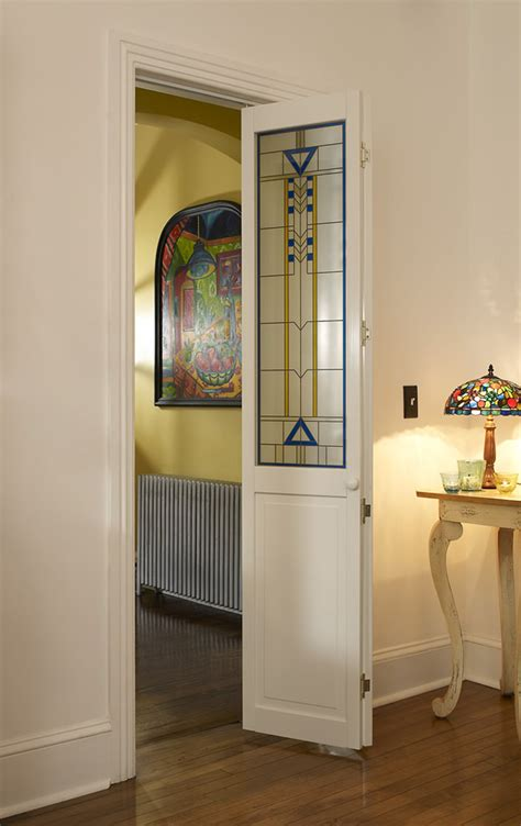 bifold doors with glass stained glass door with blue and yellow accent artiste