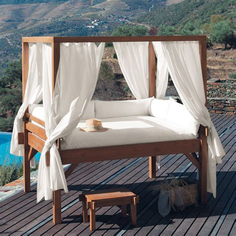 backyard bed white drapes outdoor canopy bed wooden deck wooden stool