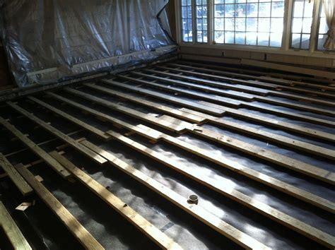 2x4 Sleepers shimmed over Concrete Slab   Once all the
