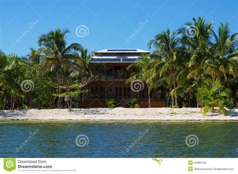coastal house plan caribbean isle tropical house with solar panels on the roof