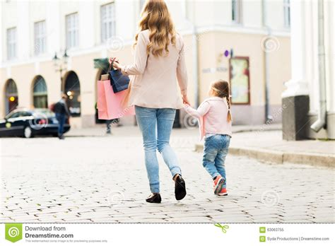 St Momy up of and child shopping in city stock photo image 63063755