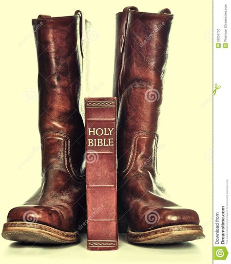 holy bible and rugged cowboy boots stock photo image
