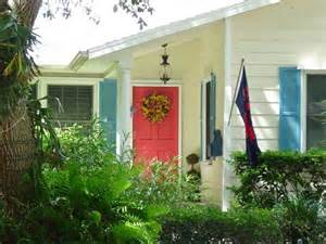 Yellow House With Blue Door by Yellow House Blue Shutters Red Door Exterior House