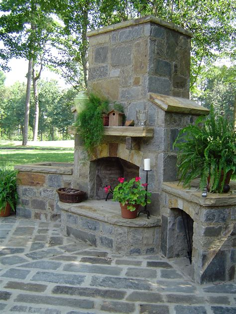 backyard country flagstone outdoor fireplace