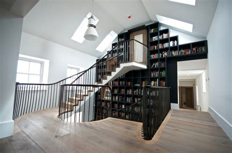 spiral staircase with a beautiful bookcase wall3 home