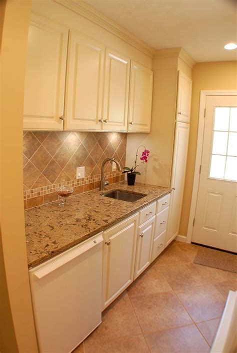 White Thermofoil cabinets with tile backsplash, Cambria