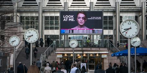 domestic violence billboard dares people not to look away women s aid interactive billboard dares you to face