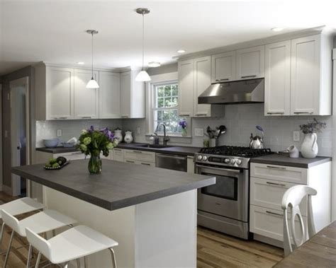 Kitchen With Glass Tile Backsplash by White Kitchen Cabinets With Dark Grey Countertops 3523