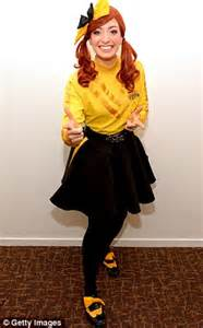 emma watkins swaps her yellow wiggles costume for a gown