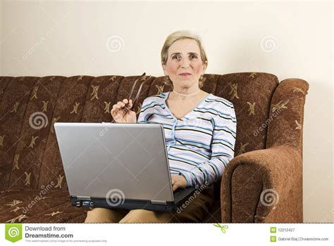 mature couch mature woman using laptop home royalty free stock