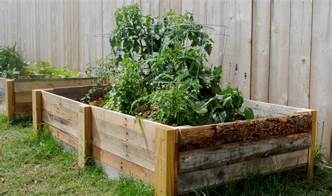 pallet raised bed diy how to build a raised garden bed using reclaimed