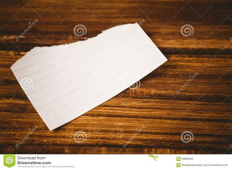 table paper scrap of paper on wooden table stock photo image 56800552