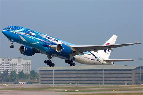 airasia mh370 malaysia airlines airasia drop share swap business