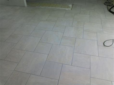 1 square ceramic tile 18x18 12x12 and 18x18 biscuit in a pinwheel pattern yelp