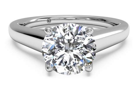 solid band solitaire engagement ring in 18k white gold