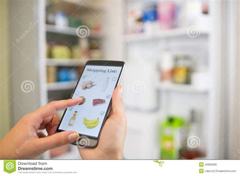 Smart Phone Smart Shopping by Makes Shopping List On His Smartphone Connected