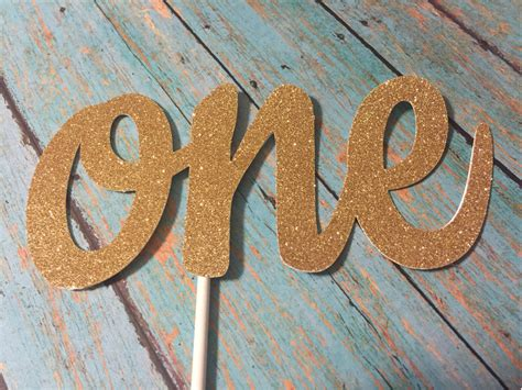 first birthday cake topper one cake topper gold by