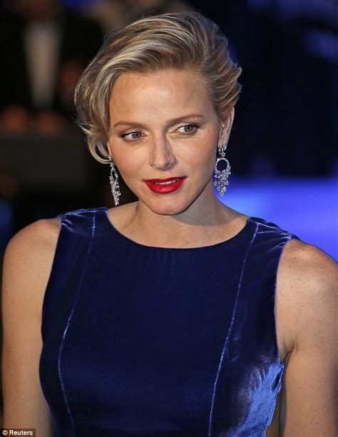Princess charlene of monaco stuns in a sapphire gown at charity gala