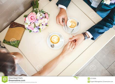 Wedding Couple At Cafe, Top View. Man Holds Woman's Hand