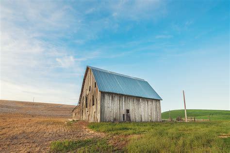 brown grey barn house  windmill  daytime