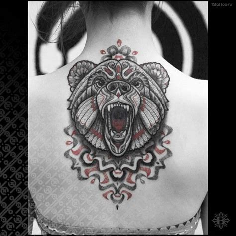 animal tattoo nature a roaring bear leaps from the center of the mandala that