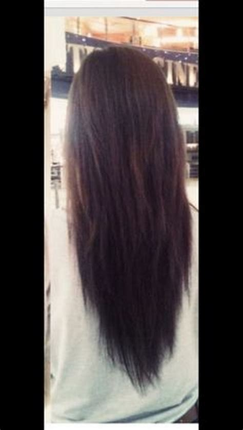 cut womens hair straight across in back long layered v shaped haircut