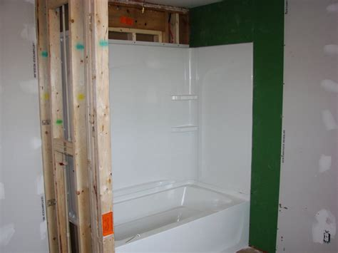 installing a bathtub and surround bathroom overhaul incl tub vanity toilet defiance