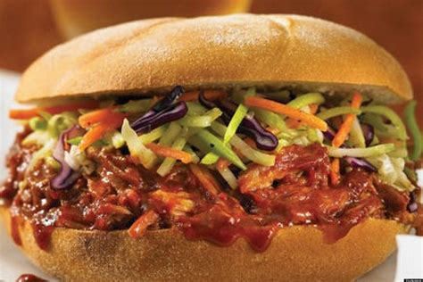 super bowl recipe serve pulled pork on a bun during the half time show