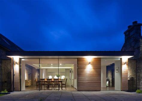 stone  glass torispardon house   modern