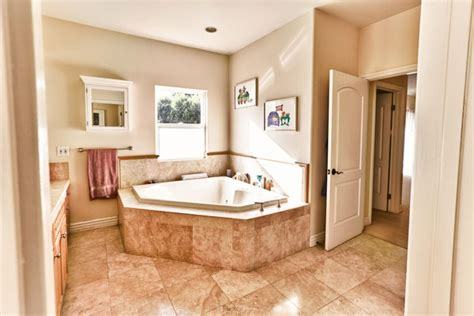 best paint color for master bathroom what color wall paint would go with a peach and brown tile