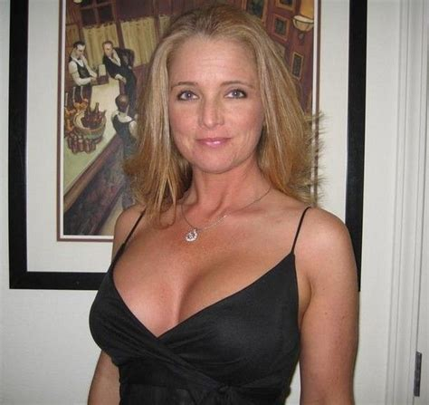 unknown 50 yr old blond women 50 plus milf amateur in a black cocktail dress naturally