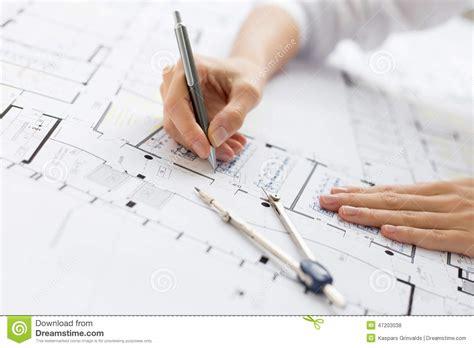 architect online architect working on blueprint stock photo image 47203038